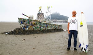 Hugo Tagholm, of Surfers Against Sewage, with a model ship made of plastic marine litter.