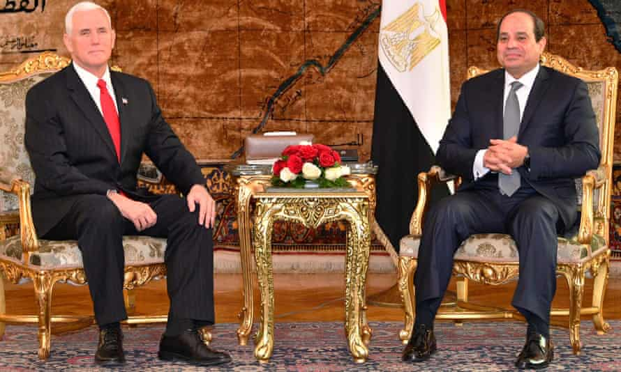 Mike Pence and Egyptian president Abdel Fatah al-Sisi pose for photographs in the presidential palace in Cairo.