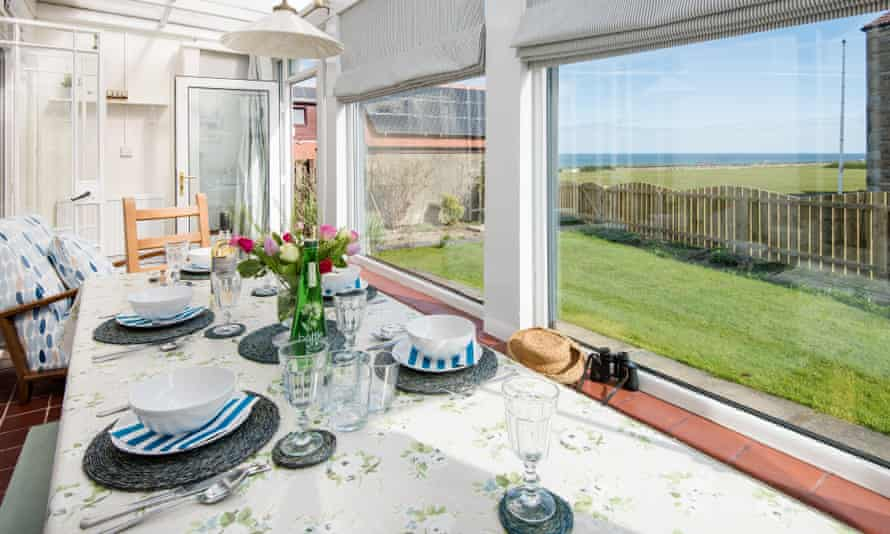 Dining table and sea view at the Tumblers