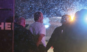 A suspect is taken into custody outside the Planned Parenthood centre in Colorado Springs, Colorado on Friday 27 November.