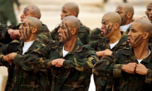 Soldiers in war paint move in unison