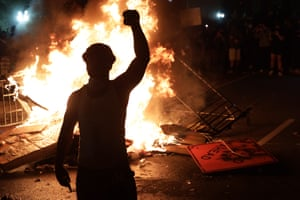 Demonstrators stand around a fire during a protest near the White House.