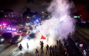 Protesters in Oakland, California, block both directions of the Interstate 580 freeway during a rally against racism in response to violent clashes in Charlottesville