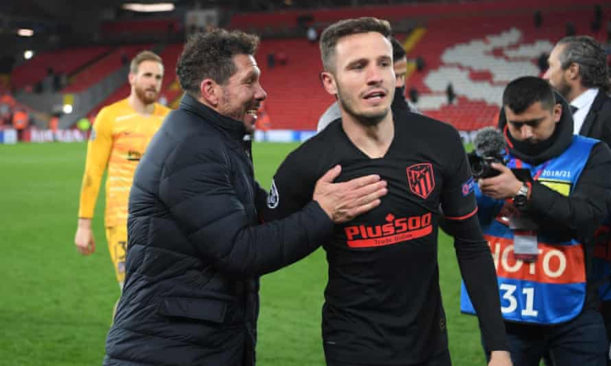 Saúl Ñíguez with Atlético's manager, Diego Simeone, after the win at Liverpool in March 2020.