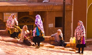 Iranian womens in the village of Abyaneh, Iran. the women are wearing colourful headscarves.