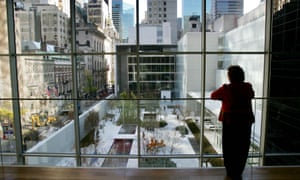 A visitor looks over the sculpture garden at New York's Museum of Modern Art, located in a Manhattan tower block.