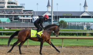 Mendelssohn canters in front of the famous spires at Churchill Downs racecourse.