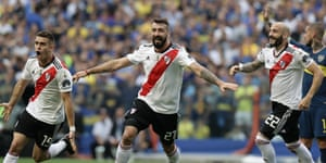 River Plate players celebrate after an own goal by Boca Juniors' Carlos Izquierdoz.