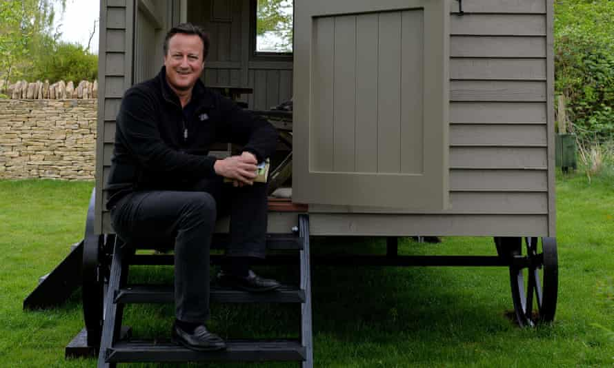 David Cameron on the steps of his luxury garden hut