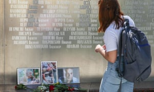 A woman views a memorial to the three killed Russian journalists in Moscow.