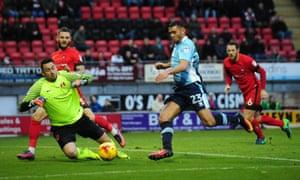 Blackpool's Colin Daniel takes on Leyton Orient goalkeeper Alex Cisak during the Tangerines' win.