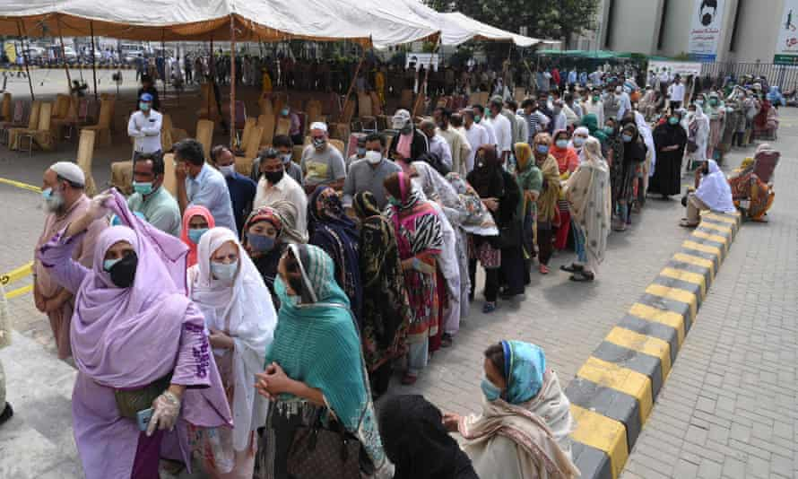 People queue for Covid vaccination in Lahore, Pakistan