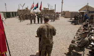 US Marine's raise the same flag as flew over Camp Bastion before their departure in 2014