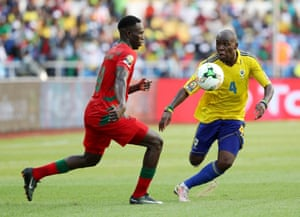 Joao Mario Fernandes, left, of Guinea Bissau challenges Gabon's Koumba Merlin Tandjigora.