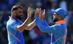 Mohammed Shami celebrates with India's captain, Virat Kohli, after dismissing West Indies' Shimron Hetmyer