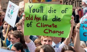 "A demonstrator holds a poster reading ""You'll die of old Age - I'll die of Climate Change"" in Frankfurt, Germany."