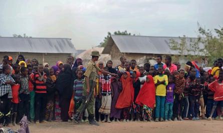 Refugees stand in line at Kenya's sprawling Dadaab refugee complex.