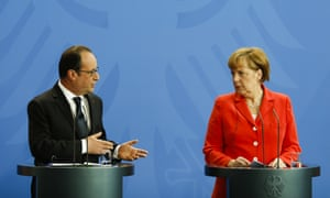German Chancellor Angela Merkel, right, and French President Francois Hollande brief the media after a meeting at the chancellery, in Berlin, Germany, Tuesday, May 19, 2015. (AP Photo/Markus Schreiber)