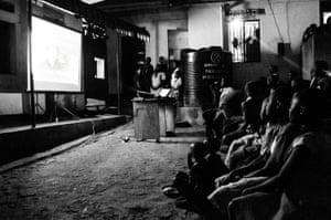 Movie night at an NGO children's home in Uganda.