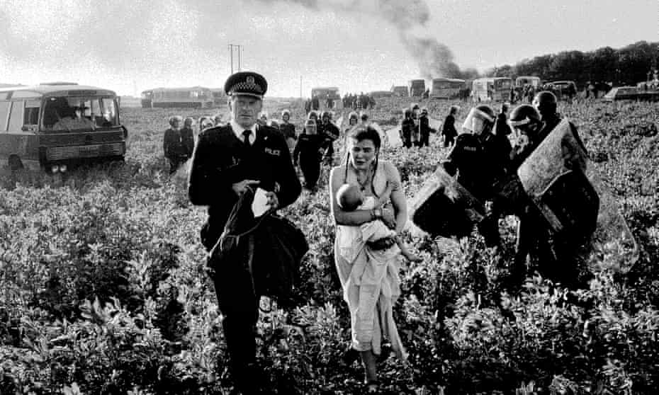 Photograph of Rose Brash being led away by a policeman