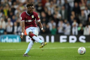 Tammy Abraham of Aston Villa takes and scores the winning penalty.