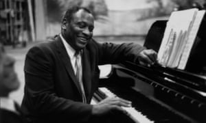 Paul Robeson in relaxed mood at the piano in 1958.
