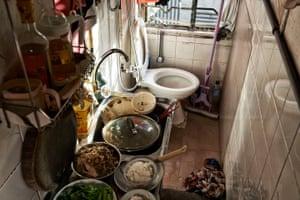 Kitchens cage homes, in Hong Kong