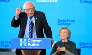 Bernie Sanders introduces Hillary Clinton at a rally promoting their college tuition plan at the University of New Hampshire on 28 September.