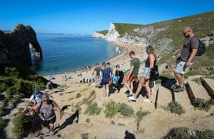 West Lulworth, Dorset Visitors make their way down steps to Durdle Door beach