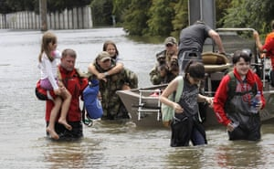 Residents are rescued from their homes surrounded by floodwaters