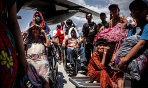 The elderly wait to board an aircraft in Palu, Indonesia, after the earthquake and tsunami