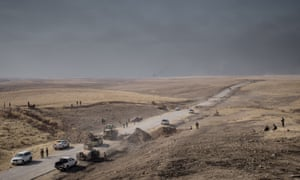 A bulldozer clears a roadblock during the peshmerga's advance near Bashiqa