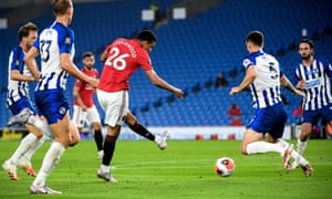 Manchester United's Mason Greenwood scores the opening goal against Brighton.