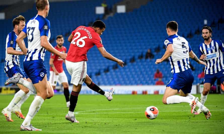 Manchester United's Mason Greenwood scores the opening goal against Brighton.