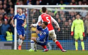 Eden Hazard goes down after a challenge by Gabriel Paulista.
