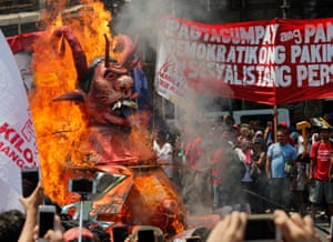 Manila, Philippines. Protesters burn an effigy mocking President Rodrigo Duterte to mark Labour Day. Various groups are rallying for worker's rights including an increase in the minimum wage, expanded maternity leave and passage in congress for a security of tenure bill