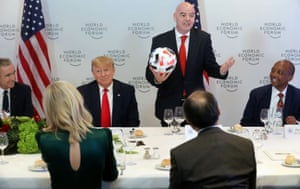 U.S. President Donald Trump listens to FIFA President Gianni Infantino speak during a dinner with global CEOs during the 50th World Economic Forum (WEF) annual meeting in Davos, Switzerland.