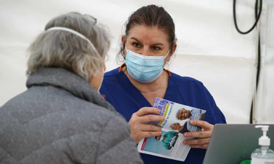 A nurse and a member of the public at the vaccination centre at Royal Cornwall Showground, Wadebridge, 1 February 2021.