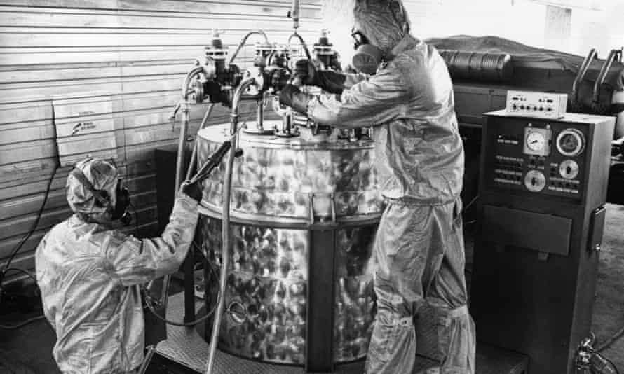 Technicians in protective suits