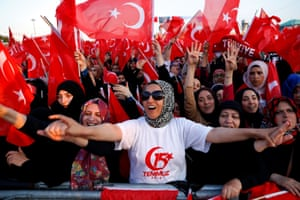 Istanbul, TurkeySupporters of Turkish President Tayyip Erdogan wave national flags during a ceremony marking the third anniversary of the attempted coup at Ataturk Airport