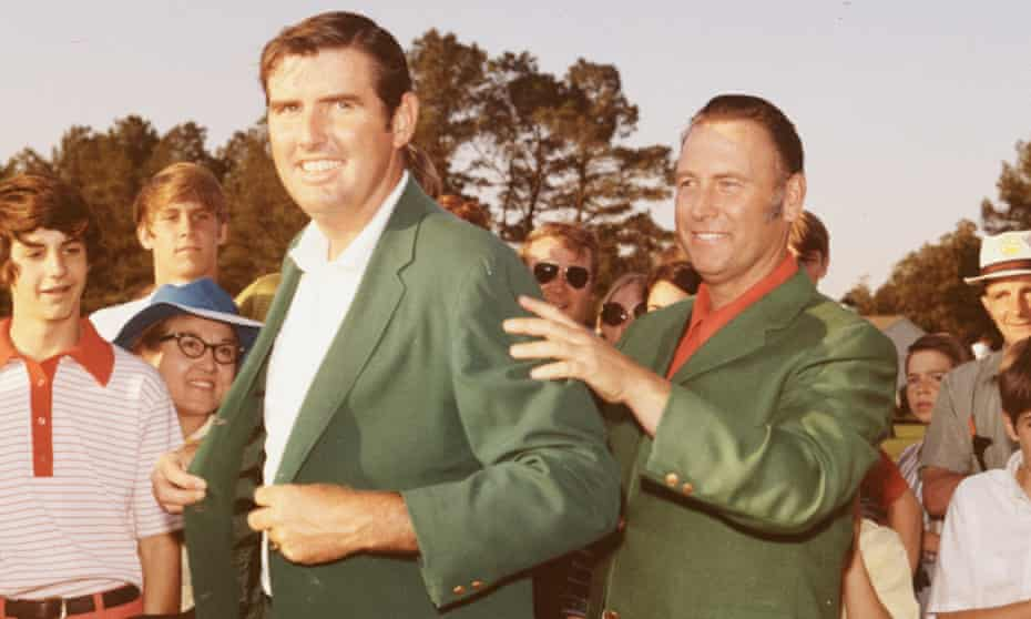 Billy Casper helps Masters champion Charles Coody with his Green Jacket at the presentation ceremony after the 1971 tournament at Augusta National