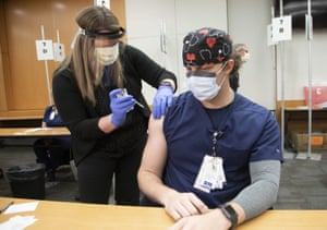 ER nurse George Biddle receives the Pfizer-BioNTech COVID-19 vaccine at the Ohio State University Wexner Medical Center.