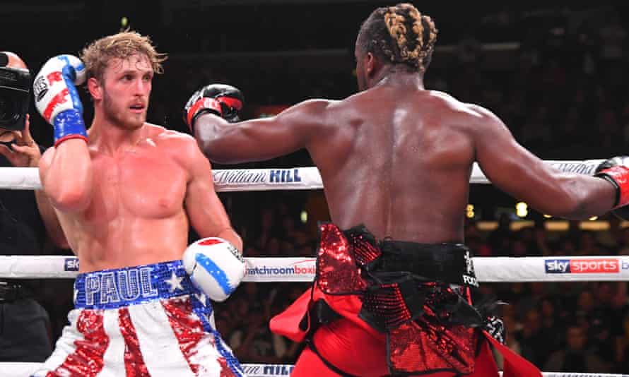 Logan Paul sways away from a punch thrown by fellow YouTuber KSI during their bout in November