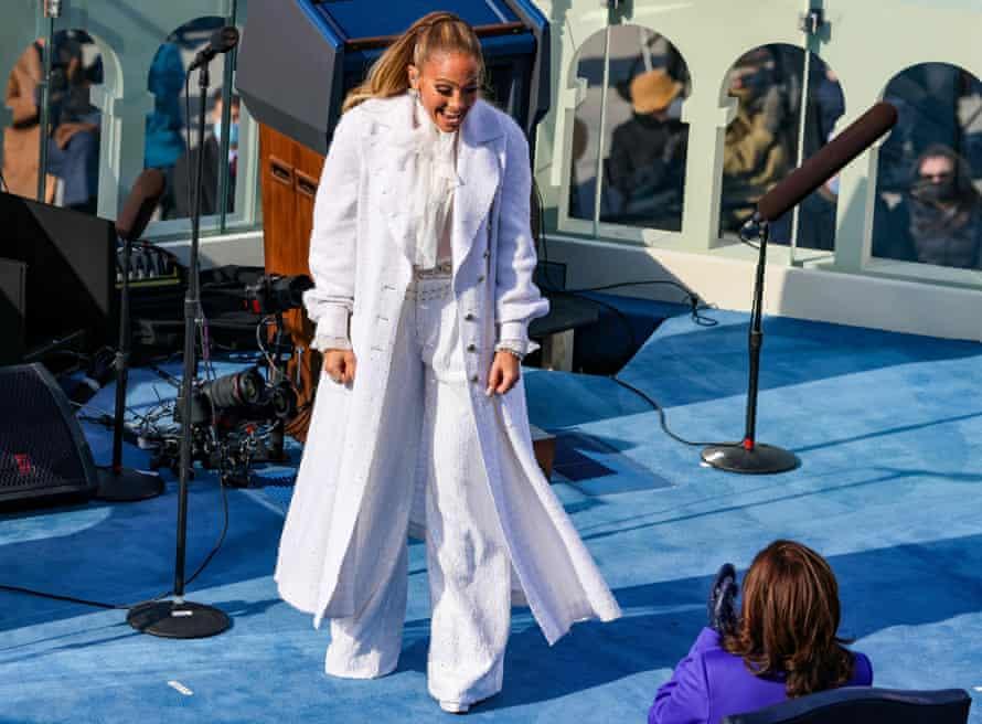 Jennifer Lopez in white Chanel, greeting Kamala Harris