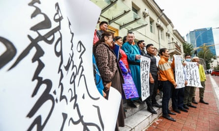 Protesters gather in Ulaanbaatar, the capital of neighbouring Mongolia, against China's plan to introduce Mandarin-only classes in the autonomous region of Inner Mongolia.