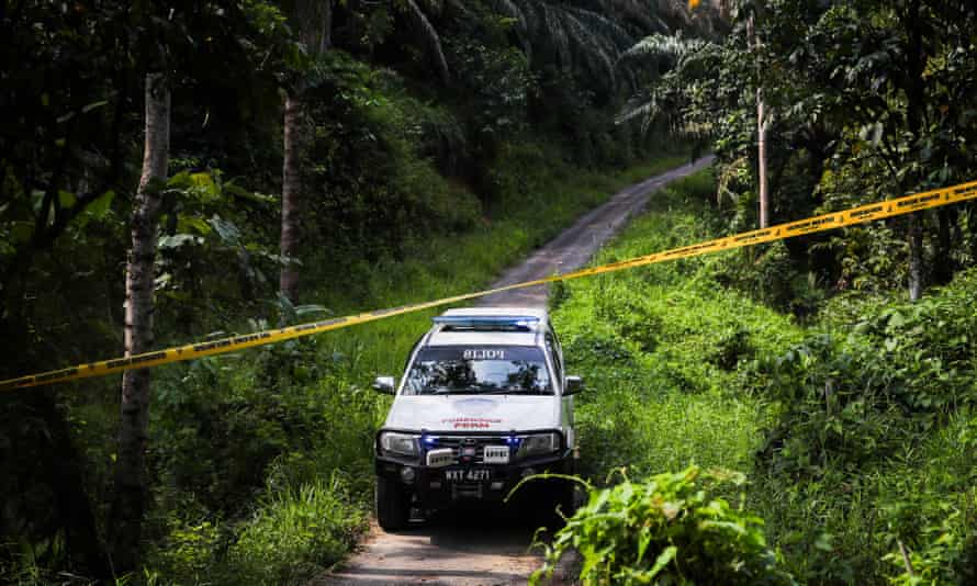 A Malaysian police forensics truck arrives in Sembilan, in the southern Negeri Sembilan state, on 13 August.