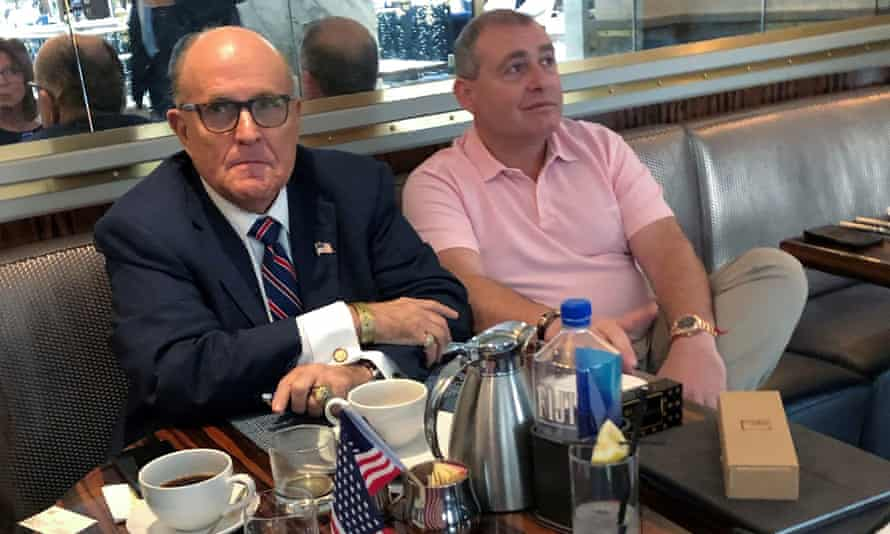 Rudy Giuliani has coffee with Lev Parnas, one of the two men arrested, at the Trump International hotel in Washington DC, on 20 September.