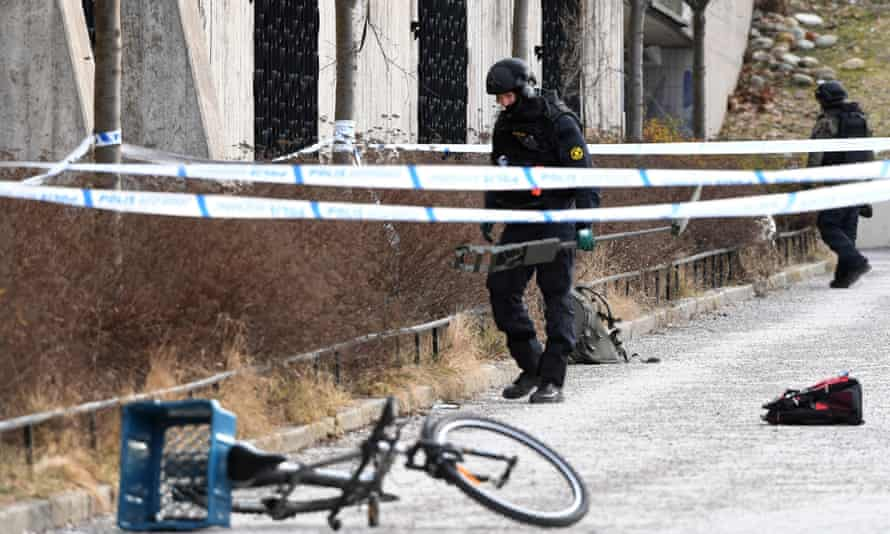 Police officers at the scene of a Stockholm metro station explosion on 7 January 2018.