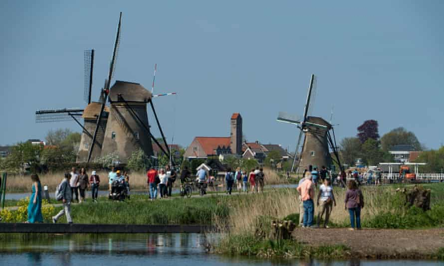 Tourists visit windmills in the village of Kinderdijk in the Netherlands.