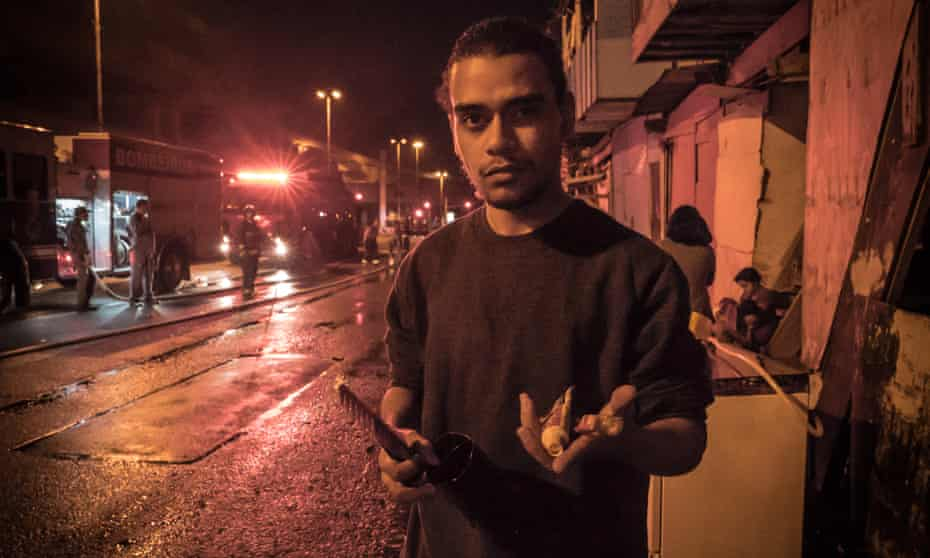 Felipe Ramon, whose house in the Levanta a Saia favela burned down last weekend, holds his remaining possessions: a toothbrush and toothpaste.